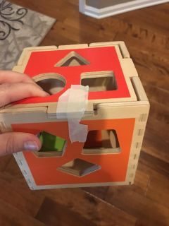 Wooden shape block with shapes