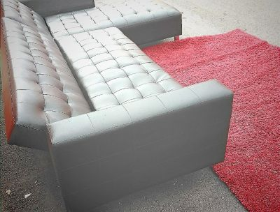 Black leather tufted couch
