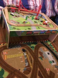 Melissa and Doug train table and race track rug both in great condition smoke pet free home both for 25$