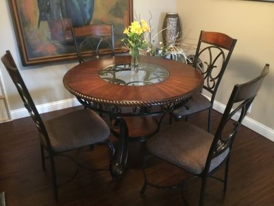 48 round x 30 wood and glass table . Excellent condition , full set with 4 chairs