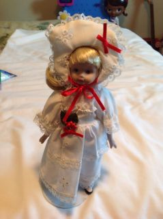 Porcelain Xmas Doll. 9 inches tall