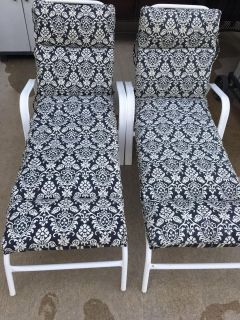 2 lounge chairs. Cushions in excellent condition - black and white-pattern or stripe. Great for pool or sun bathing. Patio furniture.