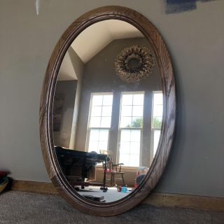Gorgeous solid oak excellent condition heavy mirror with strong hanger- measures 40 tall x 27 wide