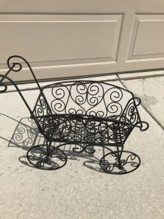 Wrought iron plant rolling cart