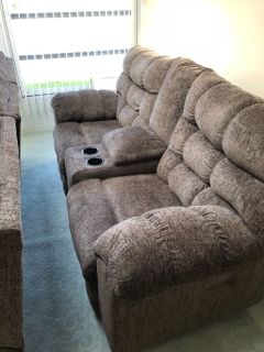 Reclining couch and love seat one month old