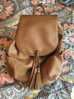 Brown backpack style purse