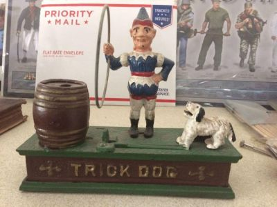 Clown with trick dog coin bank