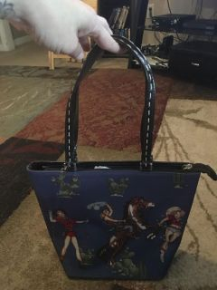 Cowgirl purse - ppu (near old chemstrand & 29) or PU @ the Marcus Pointe Thrift Store (on W st)