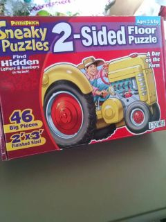Farm and tractor puzzle. Reversible. Includes seek and find letters and numbers.