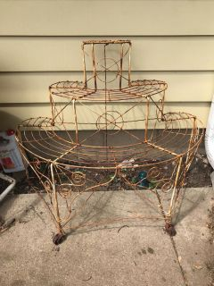 Old antique plant display metal solid with wheels