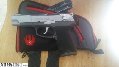 For Sale/Trade: Ruger P89 stainless,New Houge hand Grips and a Ruger gun case