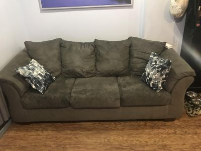 Grey couch with five year warranty