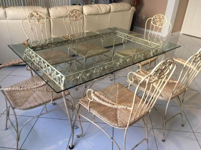 Rectangular clear glass top table with 6 chairs