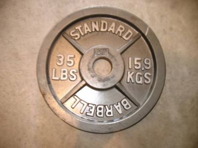 Olympic and Marcy Weight Plates 35 lbs x4, 44 lbs, and 33 lbs - x002490 (NWSA