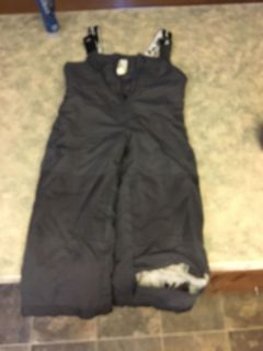 Boys ski pants size 5. One whole at the bottom of leg but the whole is not even through the pants yet can be sewed.