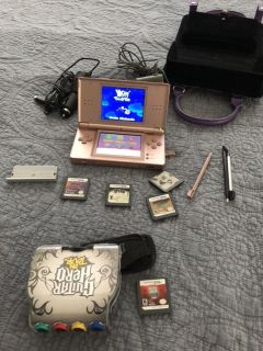 Nintendo pink DS lite game console with games and charger, plus purple carrying case. $120.00