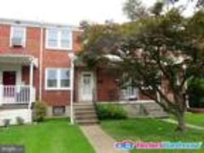 Nicely upgraded Two BR/One BA, all-brick townhouse