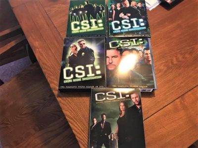 Slightly Used DVD Box Sets Of The First Five Seasons Of CSI!!