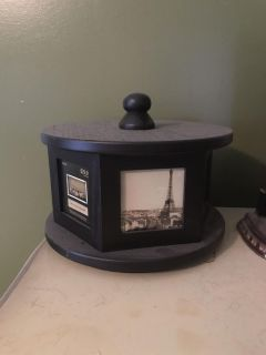 Spinning carousel picture frame with storage