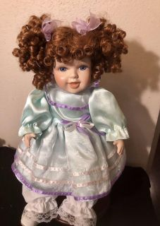 Just precious 16 Porcelain Doll with auburn curls, blue eyes, and real lashes. Perfect condition.