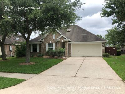 This 4 bedroom 2 bath in the desirable Brittany Lakes neighborhood is ready for move in