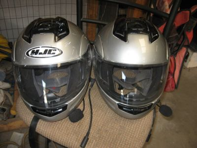 two hjc motorcycle helmets for goldwing with com systems