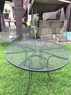 Black wrought iron table and 4 chairs