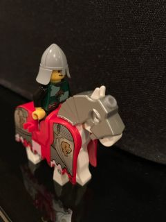 LEGO knight in armor and horse.