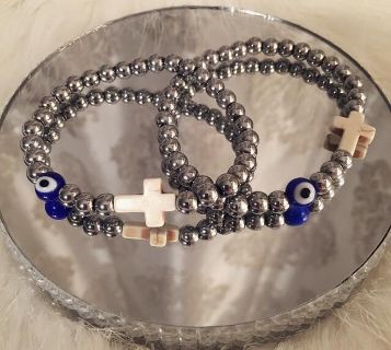 Protection bracelets. Made with silver hematite stones. Choose your evil eye bead colour.