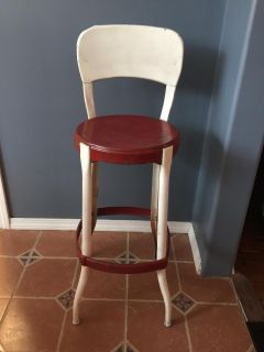 Older red and white metal chair