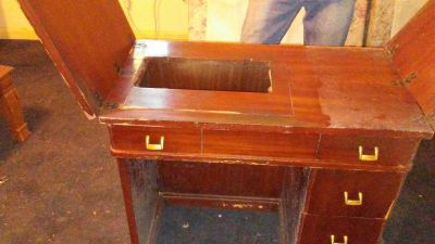 Antique sewing machine table.