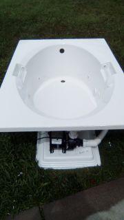White whirlpool spa bathtub