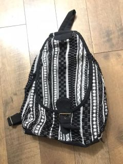 Woven material backpack