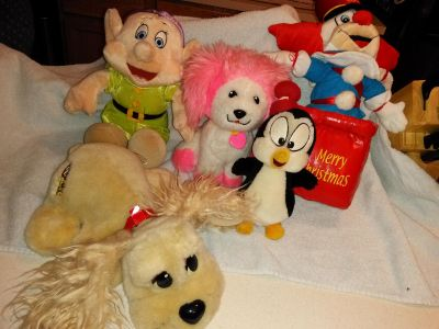 A collection of special stuffed animals Bozo the Clown Pound Puppies Dopey boochie and Chilly Willy