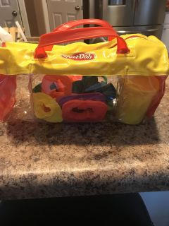 PlayDoh holder with 2 containers of PlayDoh with roller, cutter and stamps for PlayDoh