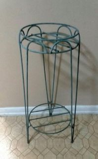 (WROUGHT IRON) PLANT STAND WITH BOTTON FOR MORE STORAGE......EXCELLENT CONDITION