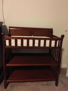 Cherry wood color changing table and pad