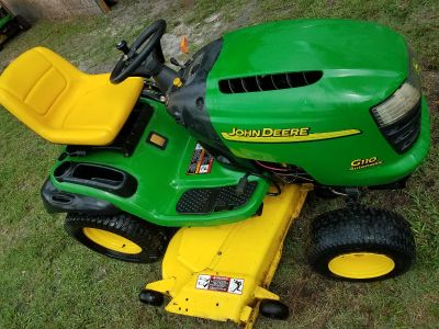 John Deere tractor and Stihl Backpack blower
