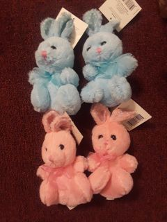 New with tags, 4 cute bunnies , pink and blue, great Mardi Gras throws or Easter
