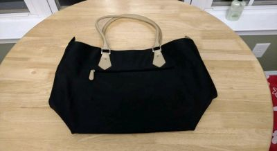"""Large black handbag with metal feet on bottom in very good condition measures 22"""" wide and 13"""" tall"""