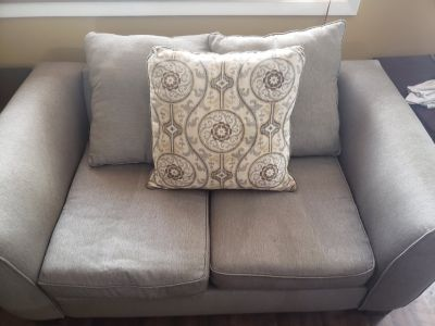 Used loveseat, sofa, and tables in good condition
