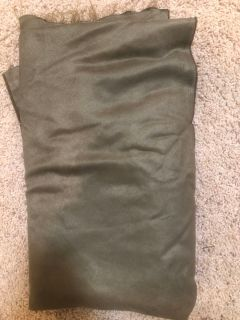 Several yards of green fabric used for table Cover