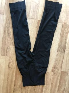 Black maternity dress pants with pockets in the front and back . Size 2