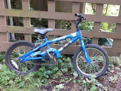 Blue ZX-50 Kids Bicycle - Fits 5 year old - Has a flat tire