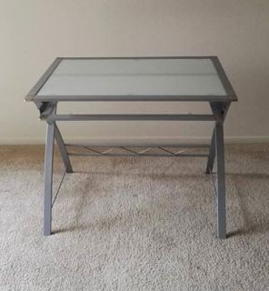 Metal and tempered glass table