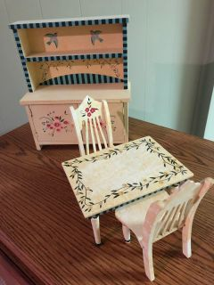 Miniature table and chairs and hutch with doors that open. Hand painted. Perfect condition.