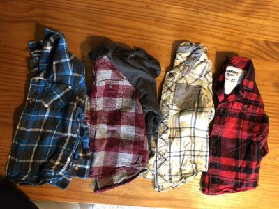Lot of flannel button up shirts