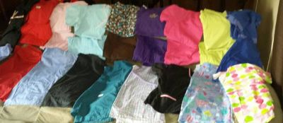 9 tops  9 sets of scrubs