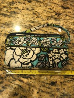 Good condition Vera Bradley small purse or wristlet with pockets for credit cards and a larger pocket with a zipper. Retired Island Blooms
