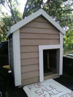 Wood dog house, about 5ft tall